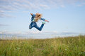 Woman jump in green grass field Royalty Free Stock Images