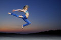 Woman jump at night professional gymnast Stock Photos