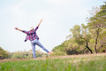Woman jumping enjoying relax on green grass and flower field in Royalty Free Stock Photo