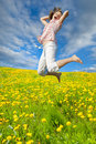 Woman jumping in field Royalty Free Stock Photo