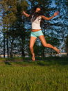 Woman jumping in field Royalty Free Stock Image