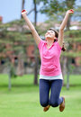 Woman jumping outdoors Royalty Free Stock Images