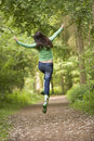 Woman jumping on path Royalty Free Stock Image