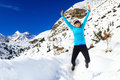 Woman jumping and running in winter mountains Royalty Free Stock Photo