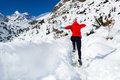 Woman jumping running in winter mountains Royalty Free Stock Photo