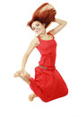 Woman jumping in studio Royalty Free Stock Photography