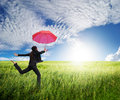 Woman jumping to blue sky  with red umbrella Royalty Free Stock Images