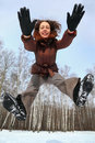 Woman jumps forward, winter day Royalty Free Stock Image