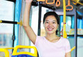 Woman keep balance by bus Royalty Free Stock Image