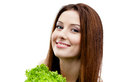 Woman keeps fresh lettuce isolated white fresh healthy dieting food Royalty Free Stock Images