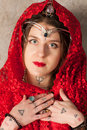 Woman with a kerchief on her head young red Stock Images