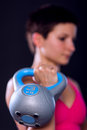 Woman with kettlebell young exercising black background Royalty Free Stock Photos