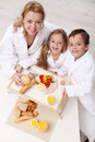 Woman and kids having a light and healthy snack happy women together Stock Image