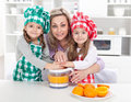 Woman and kids making fresh fruit juice Royalty Free Stock Photos