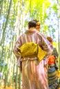 Women kimono in bamboo grove