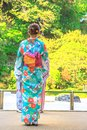 Woman kimono in bamboo grove