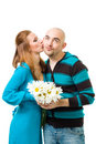 Woman kiss bold man Royalty Free Stock Photography