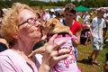 Woman Kisses Dog in Festival Contest Royalty Free Stock Photos