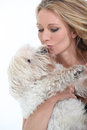 Woman kissing dog middle aged Stock Photography