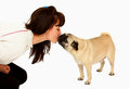 Woman kissing a dog mops Stock Photography