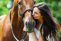 Woman kissing horse Stock Photography