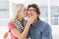 Woman kissing man on his cheek happy casual young women men Royalty Free Stock Image