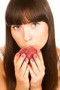 Woman kissing a peach Royalty Free Stock Image