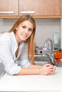 Woman in kitchen beautiful her Royalty Free Stock Photography