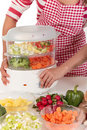 Woman kitchen vegetables Stock Images