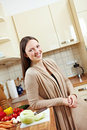 Woman in kitchen with vegetables Stock Photos
