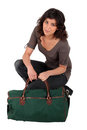 Woman kneeling by luggage Royalty Free Stock Photos