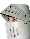 Woman with knight s helmet on the head a white background Stock Images