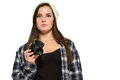 Woman in knit hat and flannel shirt holds camera hand Royalty Free Stock Photo