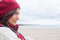 Woman in knitted hat and pullover at beach close up side view of a young the Royalty Free Stock Photography