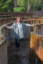 Woman in a labyrinth staying wooden palisade Stock Image