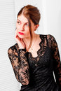 Woman in lace black dress looking to side the Royalty Free Stock Photos