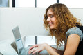 Woman with laptop attractive happy and smiling in front of display Royalty Free Stock Photography