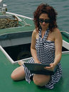 Woman with laptop on boat Stock Photo