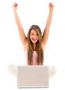 Woman with a laptop celebrating sitting her and arms up Stock Images