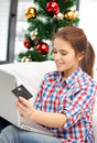 Woman with laptop computer and credit card happy over christmas tree Stock Photo