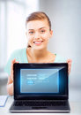 Woman with laptop computer and virtual screen picture of happy Stock Photos