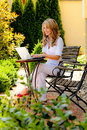 Woman with laptop in garden Royalty Free Stock Images