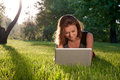 Woman with laptop on the grass Royalty Free Stock Photo