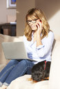 Woman with laptop at home Royalty Free Stock Photo