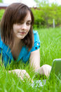Woman with laptop lying on the grass Stock Photography