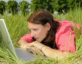 Woman with laptop on a meadow Royalty Free Stock Photo