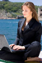 Woman with laptop near the  sea Royalty Free Stock Photography