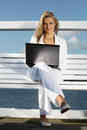 Woman with laptop on the pier young Royalty Free Stock Image