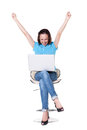 Woman with laptop raising hands up Stock Photos
