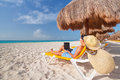 Woman with laptop relaxing on the deckchair at caribbean sea Royalty Free Stock Photography